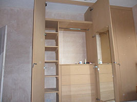 A cupboard with compartments built inside it